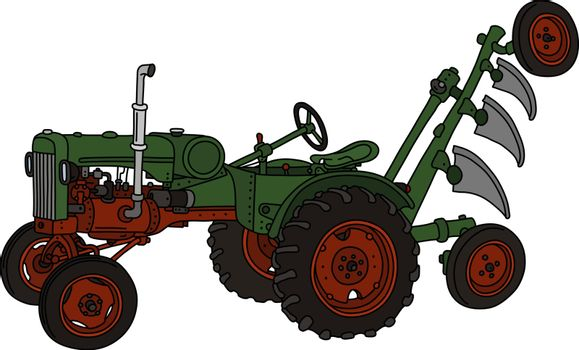 The old green tractor with a plough