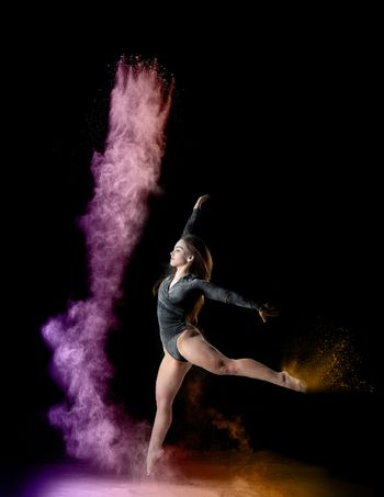 beautiful young caucasian woman in a black bodysuit with a sport