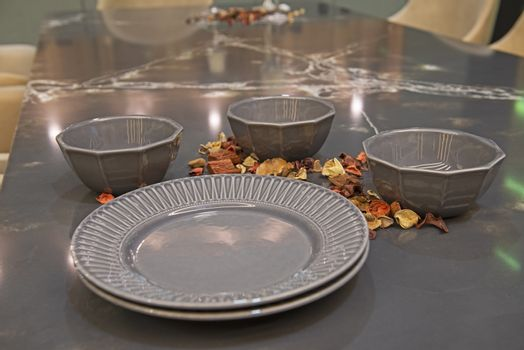 Closeup of dining crockery on marble table top