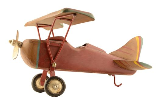 An isolated wood toy plane for the kids to play with.