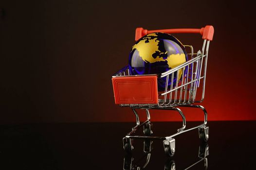 A conceptual image of global shopping over a red background.