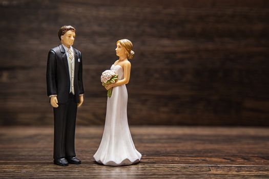 Wedding topper against wood background