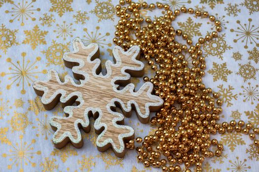 Close up of wooden snowflake decoration. Christmas composition with seasonal decorations and ornaments, christmassy mood.