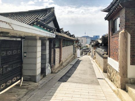 Bukchon Hanok Village And Seoul tower in daylight at Seoul, South Korea.