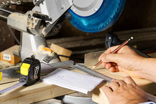 Carpenter work with circular saw for cutting wood bar, the man sawed bars, construction and home renovation. Carpenter work concept