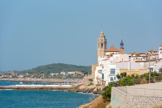 Sandy beach and historic old town in the Mediterranean complex Sitges near Barcelona, Costa Dorada, Catalonia, Spain
