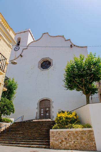 Port de la Selva, Spain : 9 July 2020 : View of The church is dedicated to Santa Maria de les Neus in Port de la Selva, one of the most touristic villages of Costa Brava, on 9 July 2020, in Port de la Selva, Catalonia, Spain.