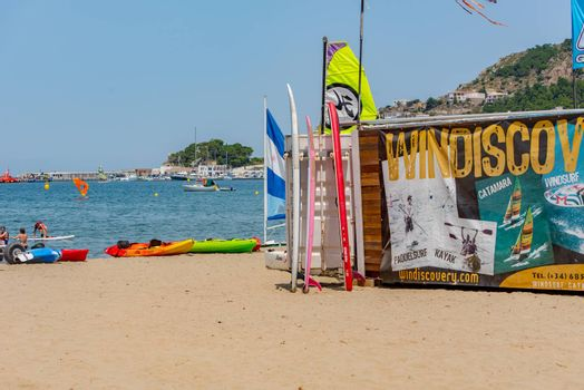Port de la Selva, Spain : 9 July 2020 : View of Windsurf shop in Port de la Selva, one of the most touristic villages of Costa Brava, on 9 July 2020, in Port de la Selva, Catalonia, Spain.