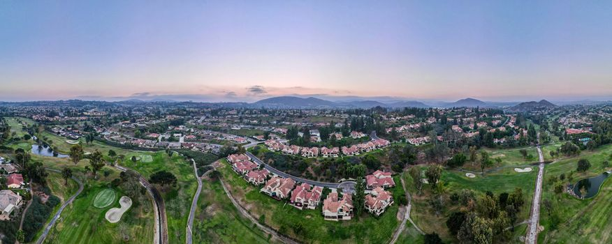 Aerial panoramic view of golf in upscale residential neighborhood during sunset, Rancho Bernardo, San Diego County, California. USA.