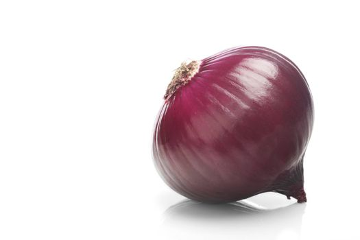 Red onions over white background