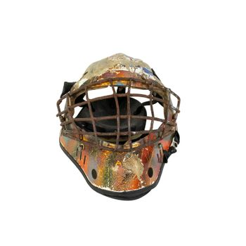 Old hockey mask for goalkeeper protection isolated on white background
