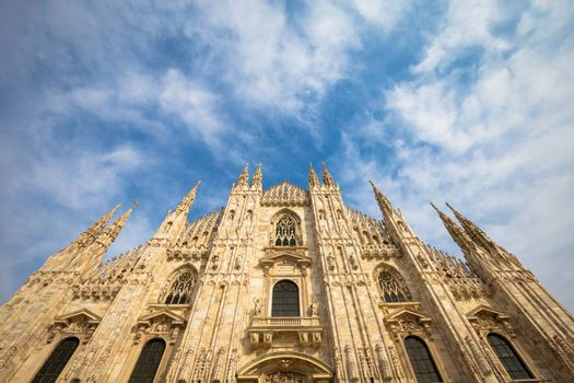 Milan Cathedral (Duomo di Milano) with copy space for text. Blue sky background and sunset light.
