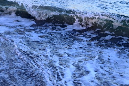 Detailed close up view on water surfaces with ripples and waves