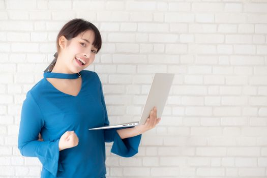 Beautiful freelance young asian woman confident using laptop com