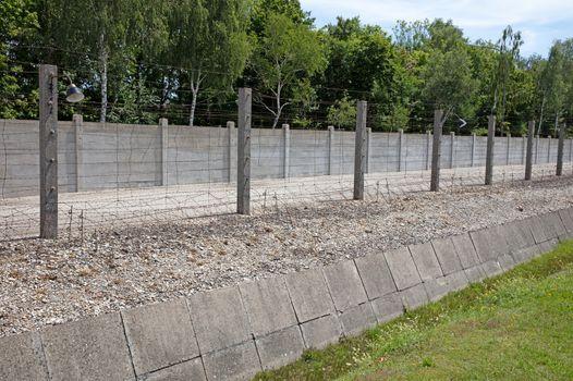 Dachau, Bavaria, Germany - July 13, 2020: Ditch and fence, Dacha