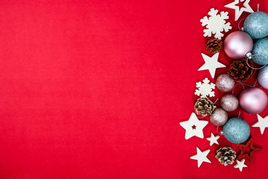 Decorated red Christmas background with christmassy ornaments and decorations. Top view with copy space Christmas composition.
