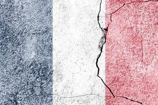 France flag on cracked concrete wall. The concept of crisis, default, economic collapse, pandemic, conflict, terrorism or other problems in the country. Abstract disaster symbol.