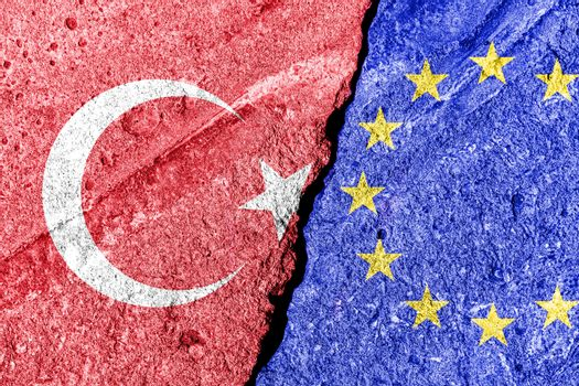 The crack between the European Union and Turkish flags. The concept of sanctions, relationship problems, confrontation and ban on tourism.