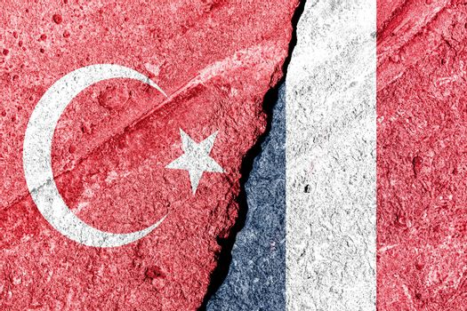 The crack between France and Turkish flags. The concept of sanctions, relationship problems, severance of diplomatic relations and confrontation.