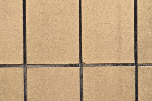 Detailed close up texture on structured floor tiles on the groun
