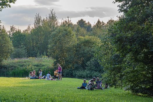 Russia, Moscow-08/20/2016: family vacation on the green grass near the reservoir. Stock photography