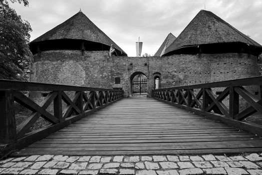 Bridge over the moat and a medieval fortified castle in Miedzyrzec