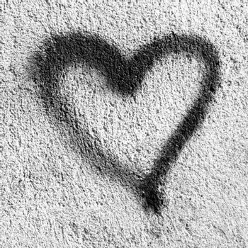 Black heart on grungy wall. Black Heart symbol painted on rustic wall. Ideal for Valentine's Day concept.