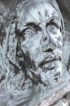 Bas-relief of Jesus. Antique statue of Jesus Christ face. Religion, vintage, faith, history, suffering concept.