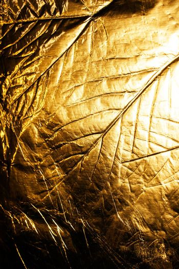 A gold Holographic Foil Leaf and Leaves with Veins Texture Shiny Pattern