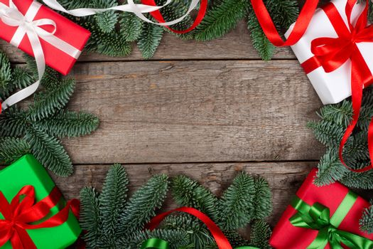 Christmas or New Year background composition made of Xmas decorations and fir tree branches and gifts with copy space for text