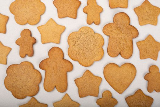 Gingerbread men stars and snowflakes not glazed cookies Christmas background