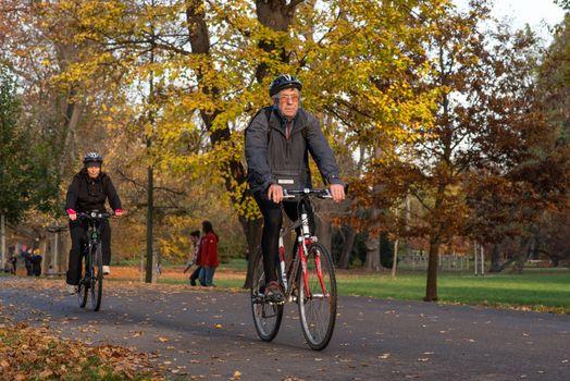 11/14/2020. Park Stromovka. Prague. Czech Republic. A man is riding his bike at the park on a winter da