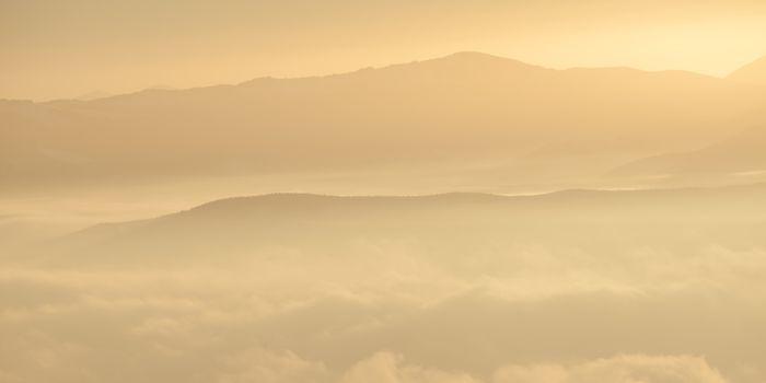 Beautiful Mountain Peaks in the Morning Fog at Cold Autumn Morning. Carpathian Mountains, Ukraine