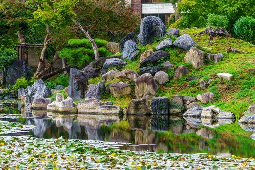 View of pond and rock reflection in the Shosei-en Garden (Kikoku-tei), in Kyoto, Japan