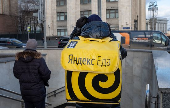 February 5, 2020 Moscow, Russia. An employee of the Yandex Food delivery service on a Moscow street.