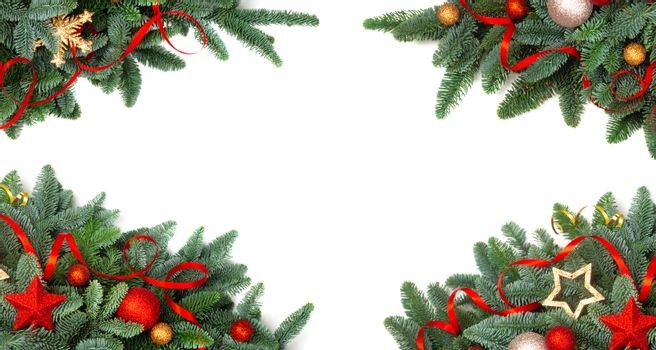 Christmas design element border frame of noble fir tree branches and red and golden baubles isolated on white background