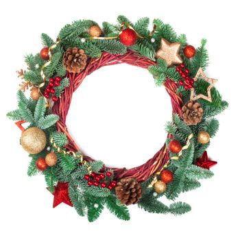 Decorated Christmas wreath with pine cones and ornaments red and golden baubles stars and holly berries isolated on white background