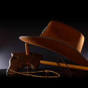 A wooden horse and hat for a playful cowboy theme.