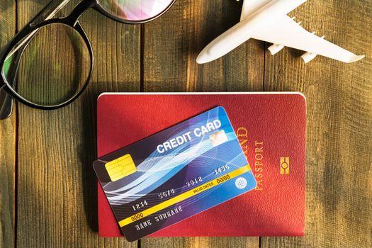 Credit card put on passport on wooden desk , Preparation for Traveling concept