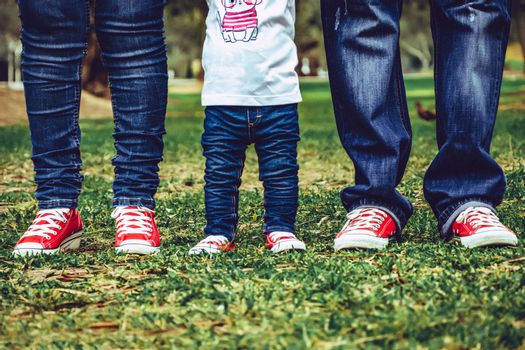 Beautiful young family. Legs of mother, daughter and father