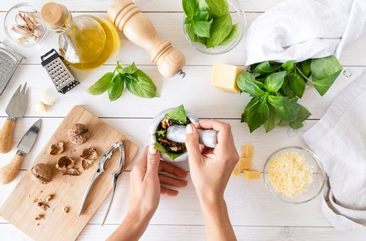 Step by step preparing italian pesto sauce. Step 6 - pounding with a pestle till smooth paste