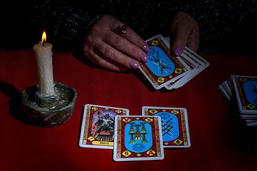 A woman reads Tarot cards