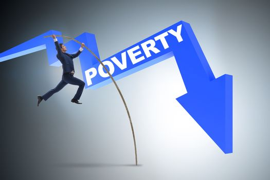 Businessman jumping over poverty in business concept