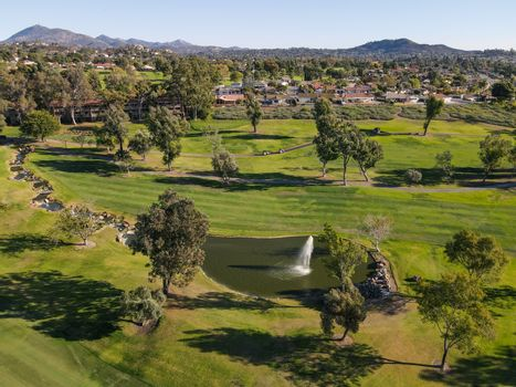 Aerial view of golf in upscale residential neighborhood during autumn season, Rancho Bernardo, San Diego County, California. USA.
