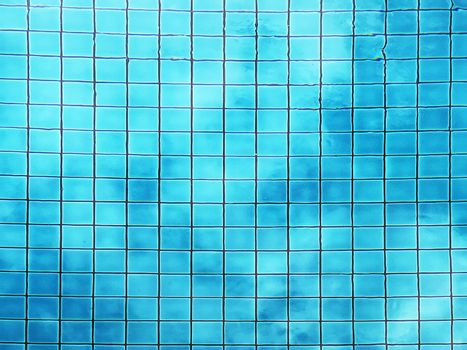 Top view of swimming pool bottom caustics ripple and flow with waves background. Summer background. Texture of water surface.
