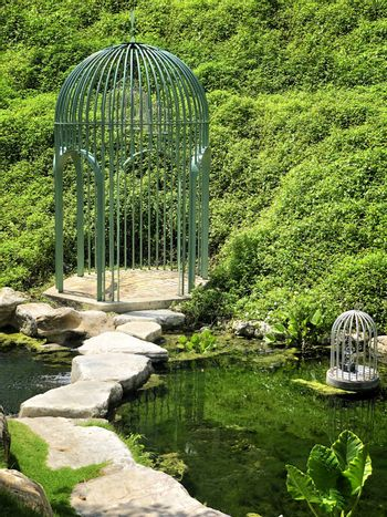 Big cage in a beautiful green garden