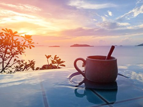 Vintage cup of hot coffee  beside the pool in morning view