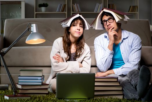 Two students studying late preparing for exams