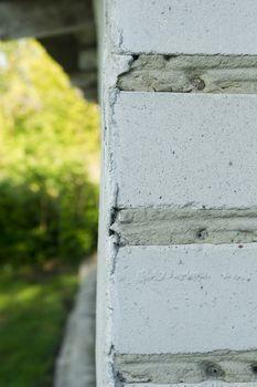 Brick corner of a house outdoors close up