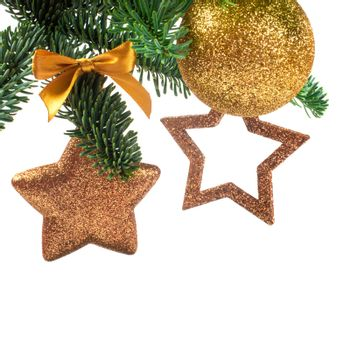 Christmas evergreen spruce noble fir tree and golden glitter glass bauble balls and stars isolated on white background